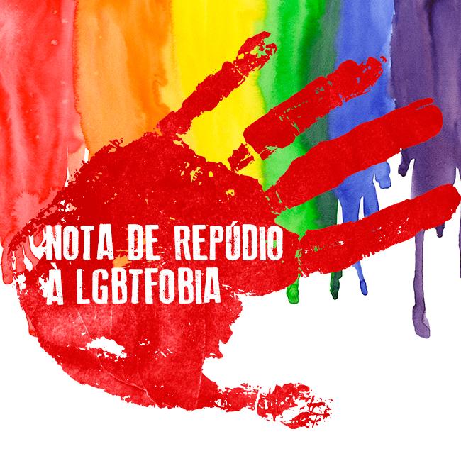 Imagem mostra cores da bandeira LGBT com marca de mão marcada por sangue