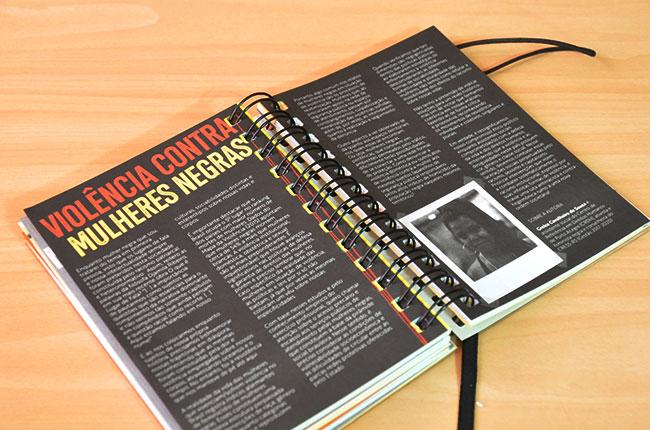 Imagem mostra página interna da agenda, que traz um texto sobre a violência contra as mulheres negras.